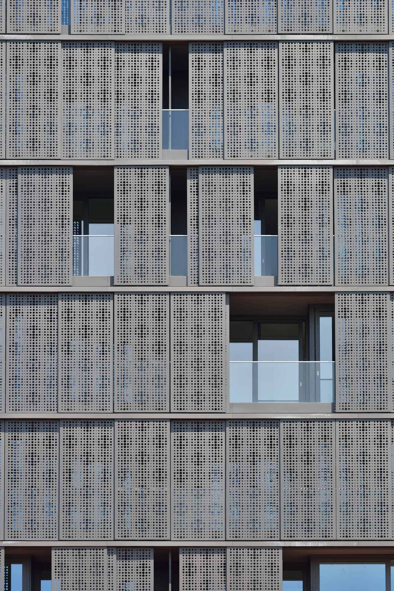 The sliding perforated aluminium panels cladding the building, allow ...