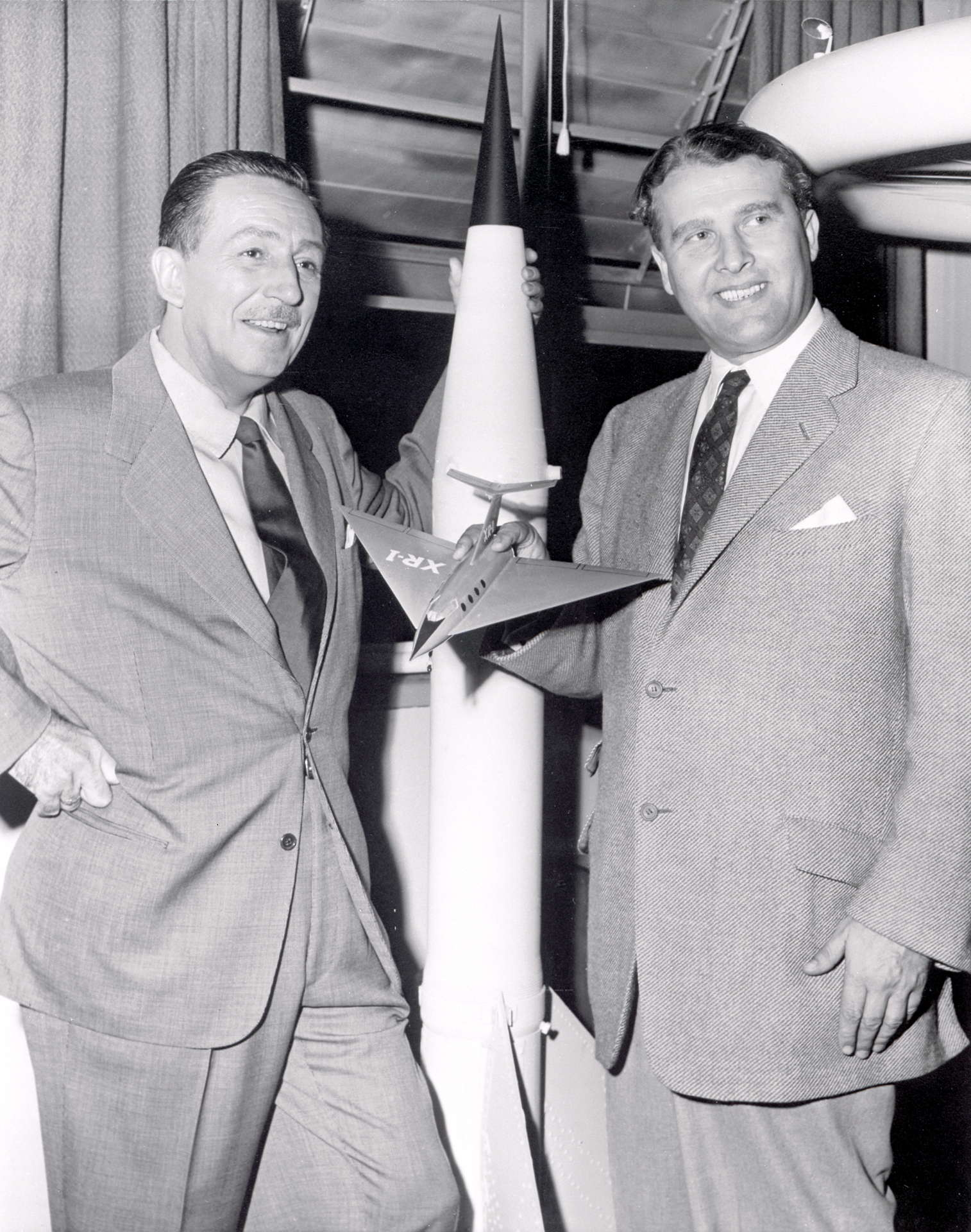 Tainted love von braun posing with walt disney left in front of a