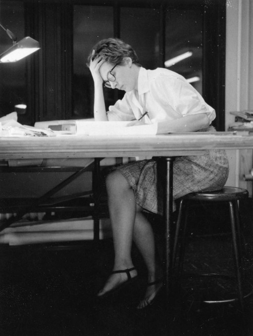 Phyllis Lambert at drafting table in Mies van der Rohe's office, Chicago. (Photo: Ed Duckett, summer 1959; Fonds Phyllis Lambert, CCA, Montreal)