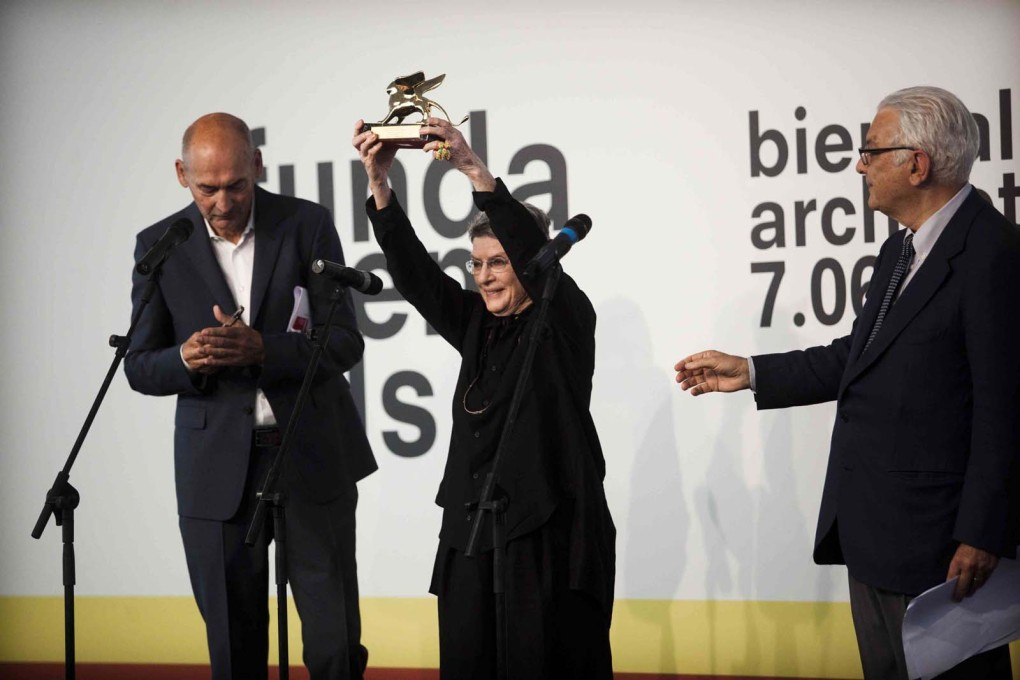 Phyllis Lambert receiving the Golden Lion for Lifetime Achievement at the 2014 Venice Biennale, from Rem Koolhaas (left) and Paolo Baratta (right). (Photo © Italo Rondinella, 2014; Courtesy: la Biennale di Venezia)