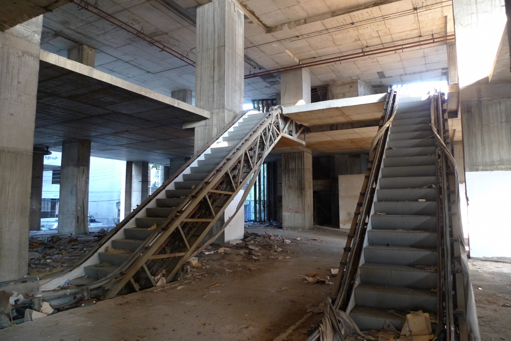 Escalators to nowhere. The fit-out had started before all the workers downed tools and left site back in 1997. (Photo: Flickr: imp1/CC BY-NC-SA 2.0)