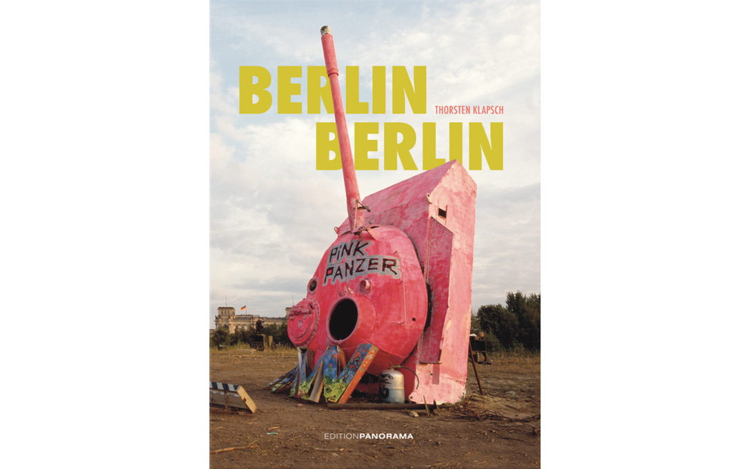 "Thorsten Klapsch's cover photo for his book ""Berlin Berlin"", shot in 1992, showing the famous ""Pink Panzer"" tank on derelict land in front of the Reichstag."