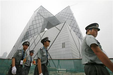 "Though Koolhaas and Scheeren designed the CCTV building as a ""democratic loop"" of interconnected programs and people, the complex is now guarded around the clock by the People's Armed Police. (Photo: Reuters)"