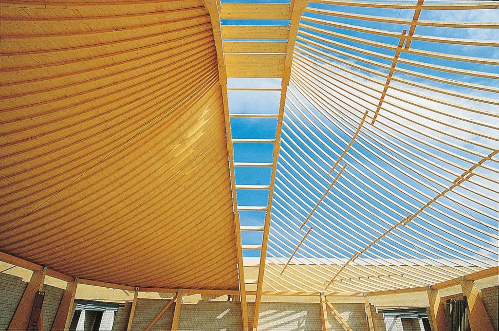 Construction shot, showing the timber roof structure designed by Frei Otto.