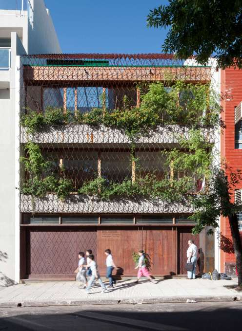 "Located on a typical Buenos Aires 8.66 metre wide plot, ""Casa Scout"" presents a façade to the street typical for the city – wall-to-wall concrete beams and floor-to-ceiling openings – but with a twist..."
