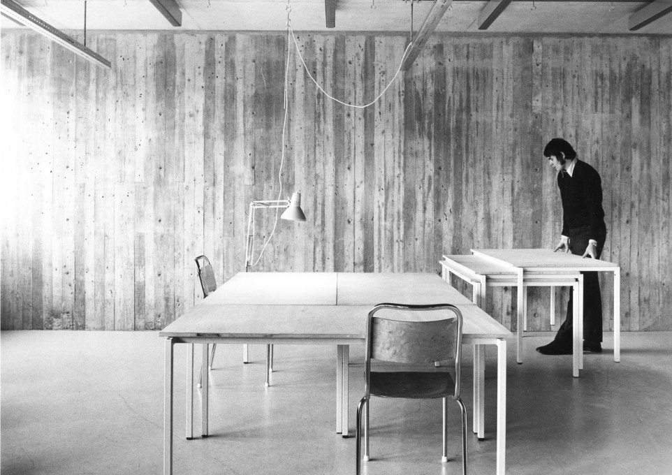 The project's young interior architect, Bror Martin Nilsson, demonstrates the stackable drawing tables of his design. (Photo: Sten Vilson, 1970)