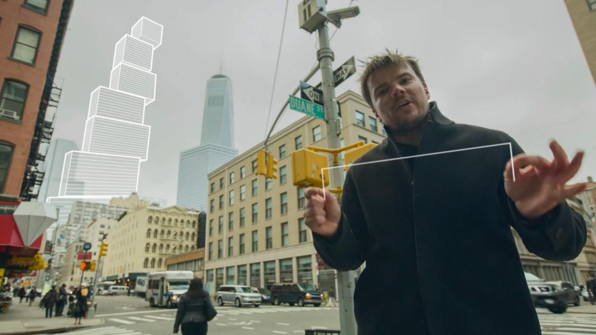 "Still from 2 World Trade Centre tower promo by BIG, with Bjarke Ingels ""like a magician ...conjuring animated diagrams out of thin air..."" – here a ""vertical village"" over grey, gritty Tribeca. (Video: BIG, Squint/Opera)&a"