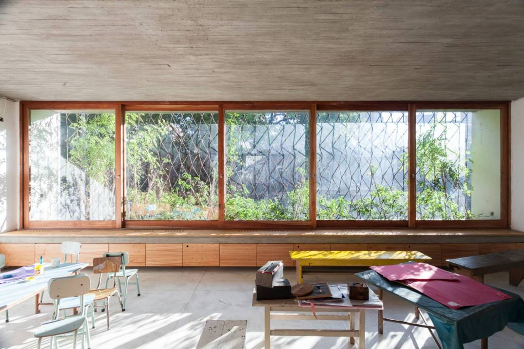 Through the almost full height windows more light enters, dappled by the iron trellis and plants outside...