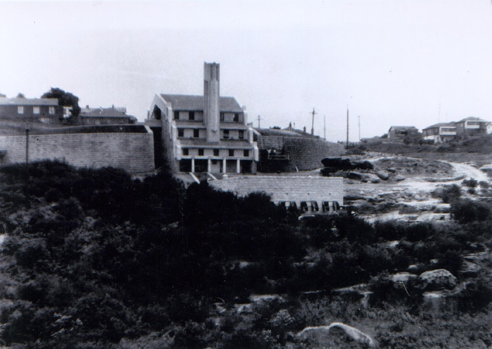 View across the gully in the 1930s, during construction, looking north towards the southern façade of the incinerator, showing the different levels of the building stepping down the site. (Photographer unknown, courtesy SJB Architects/Willoughby