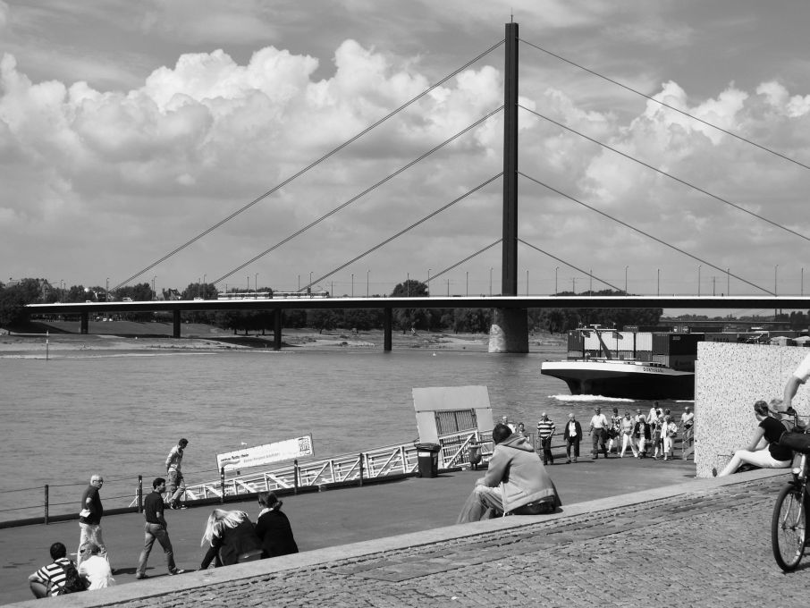 The images have an austerity which blends beauty and boredom. Oberkasseler Brücke, Düsseldorf 2010. Photo: Arne Schmitt