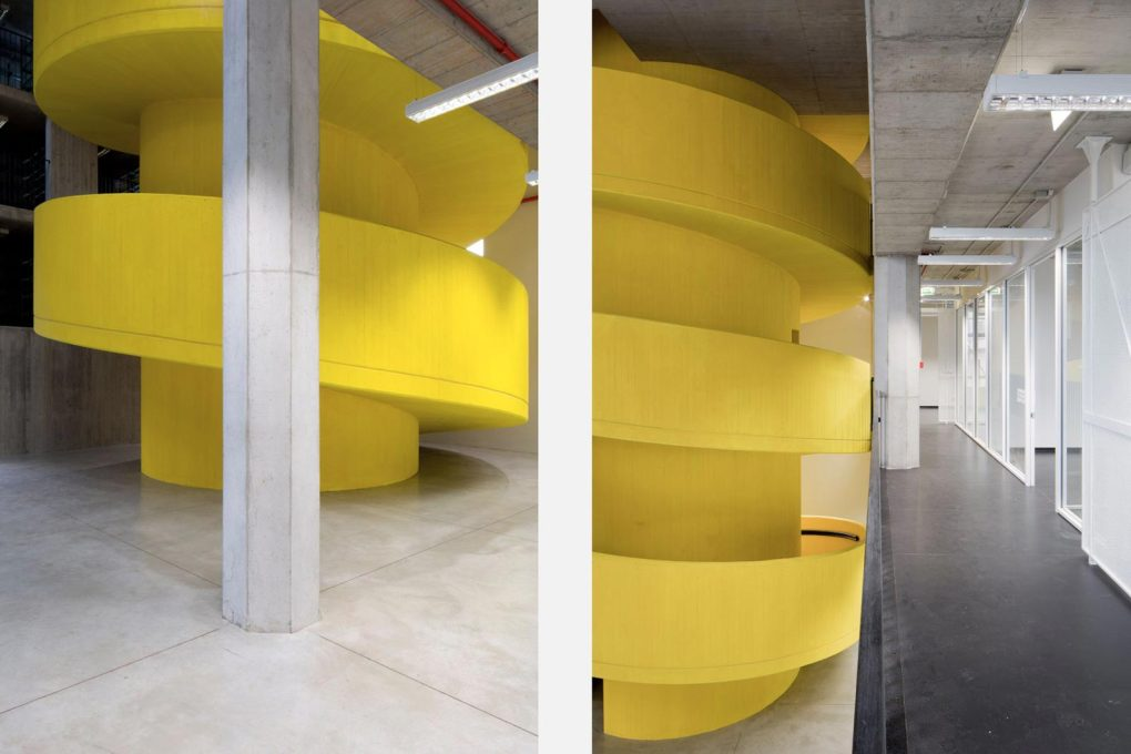 A yellow spiral staircase pierces the full-height of the building's volume, leading the visitor metaphorically through the twist and turns of Milan's collective memory. (Photo: Stefano Graziani)