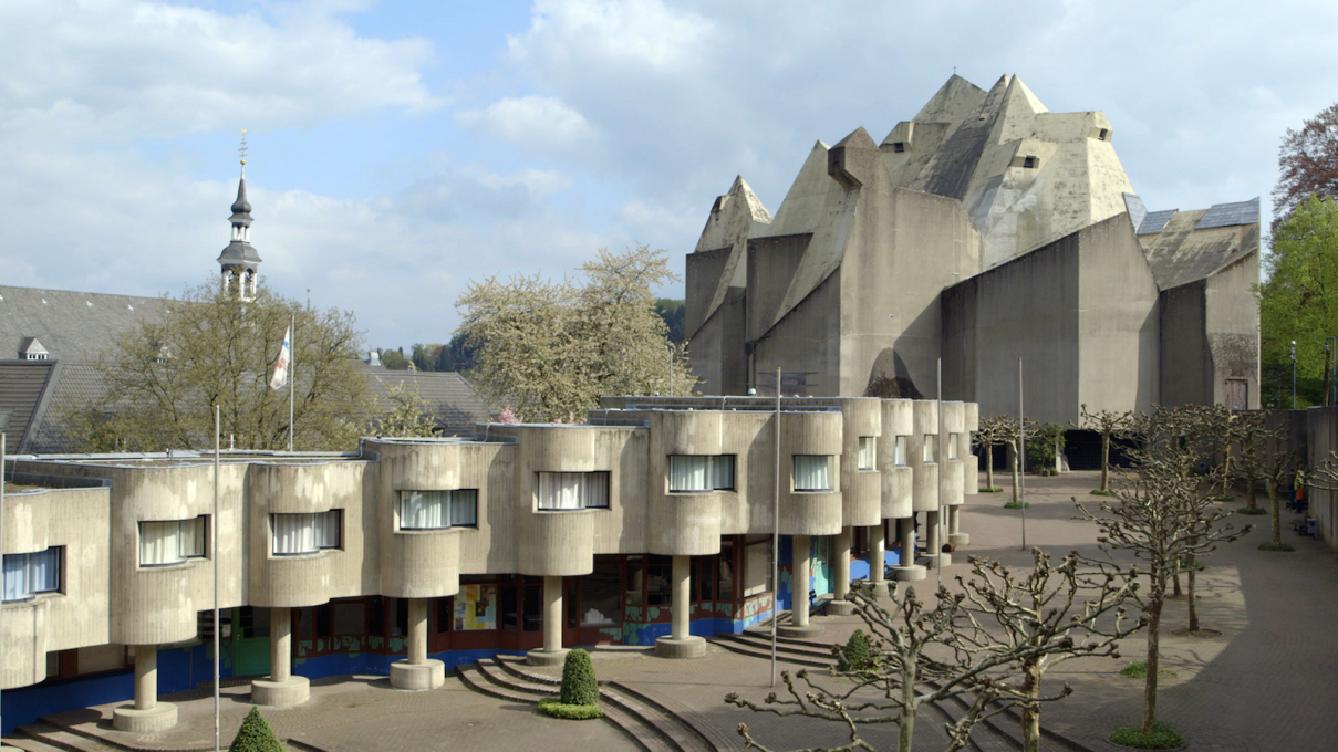 Gottfried himself is best known for his sculpturally expressive concrete structures, such as the Pilgrimage Chuch in Neviges, Germany.