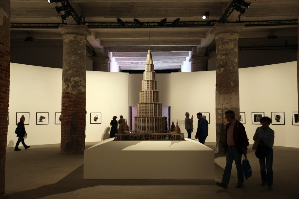 "The first room of the Arsenale, dominated by the model of ""The Encyclopedic Palace"", constructed by Marino Auriti in his garage. (Photo: Bruno Cordioli, Courtesy la Biennale di Venezia)"