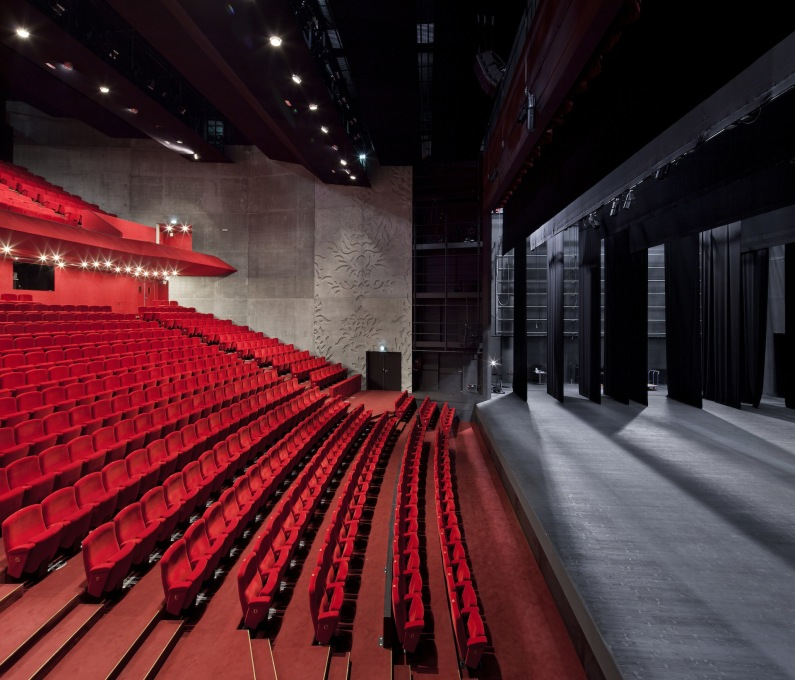 The vividly colored auditorium and seats. (Photo: Luc Boegly)