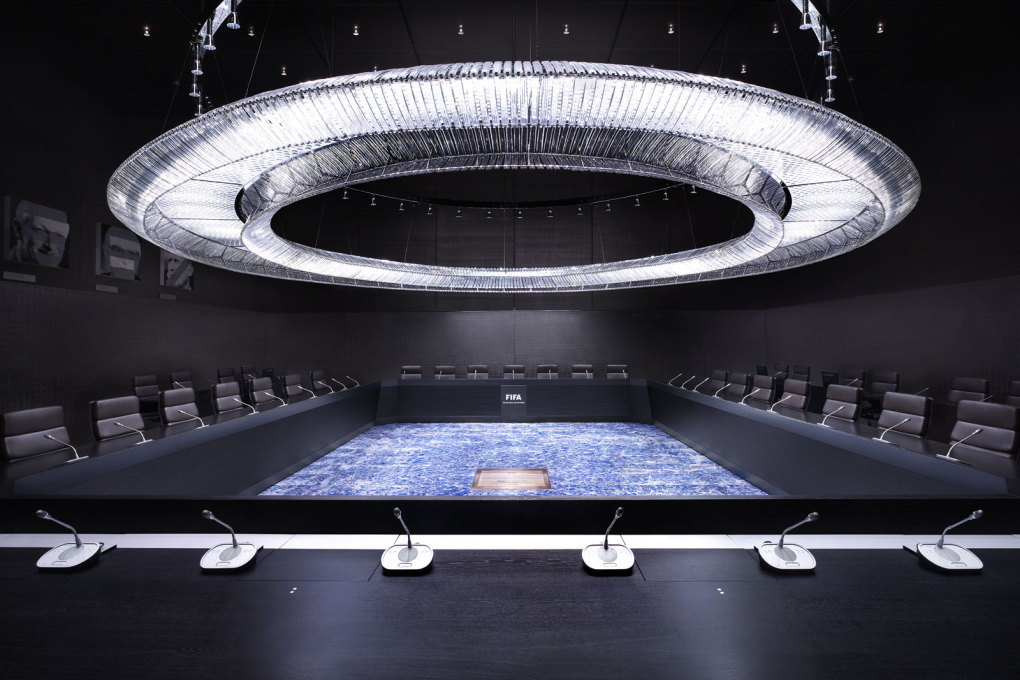 "FIFA Executive Committee Room, Zurich, Switzerland, 2013. An underground meeting hall, its huge crystal chandelier shaped like an arena, where as FIFA President Joseph Blatter says, the light must ""come from people who are in there""."
