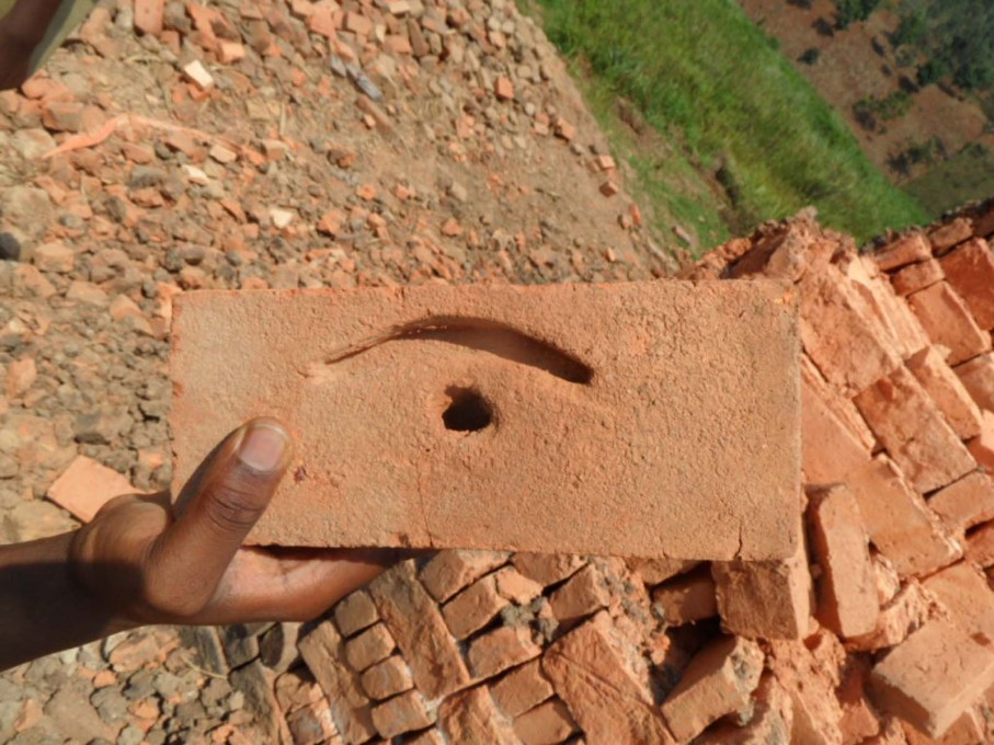One of the bricks made on site, dried and ready for use. (Photo courtesy Yves Alain Twizeyimana)
