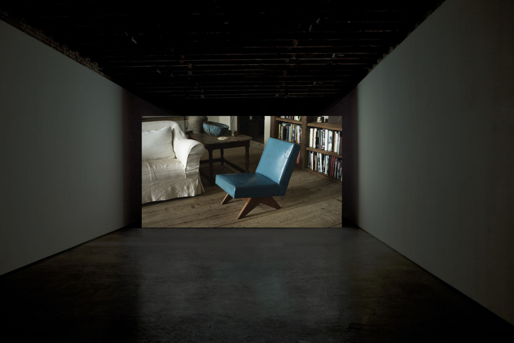 Installation view at Simon Preston Gallery, New York in 2013. The film follows the journey of pieces of furniture designed by Le Corbusier's cousin Pierre Jeanneret...