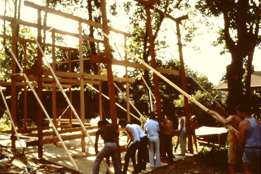 Frame-raising as a communal activity. c1970s. (Photo courtesy Jon Broome)