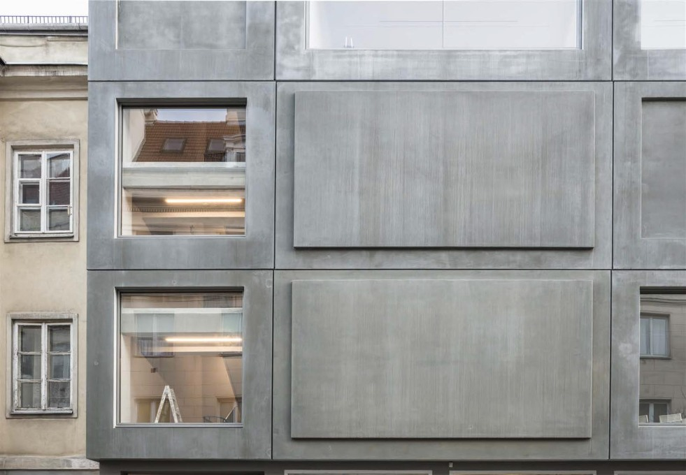 The light, four-centimetre-thick concrete panels hang off the existing structure.