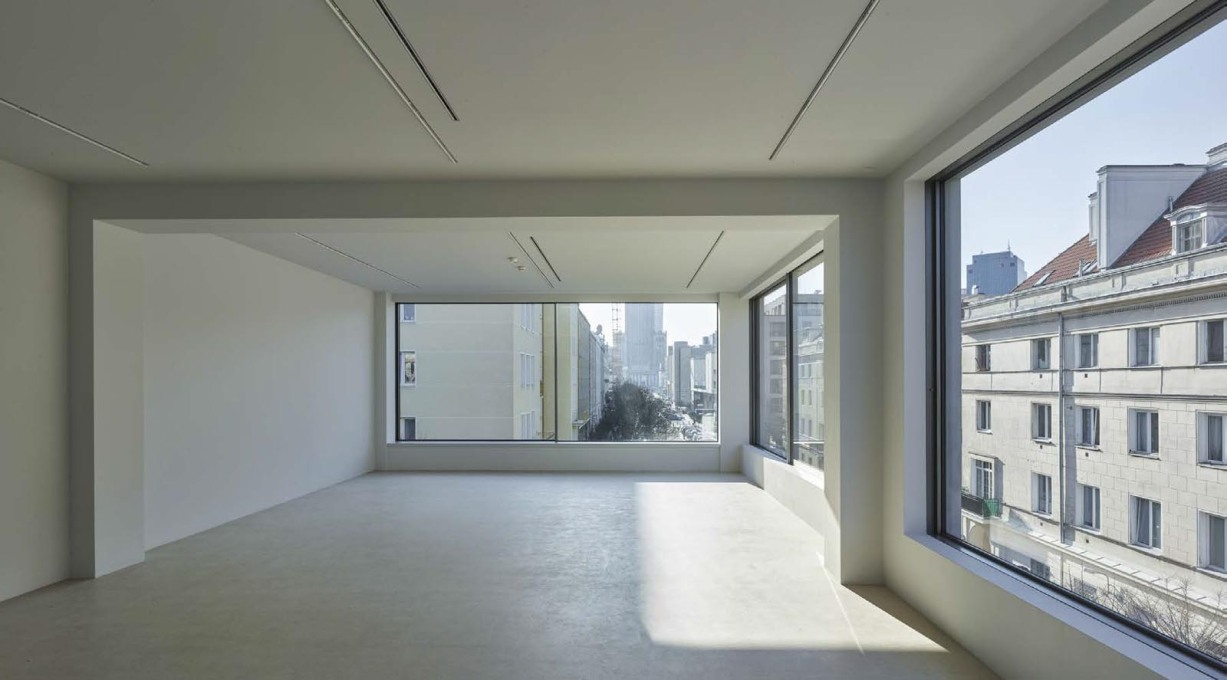 Gallery spaces drenched in light from the large glazed openings.