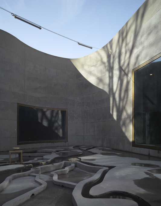 Tall walls of rough concrete surround the patio... (Photo: Bas Princen)