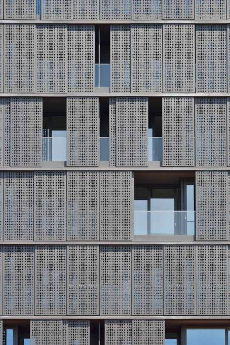 The sliding perforated aluminium panels cladding the building, allow each resident to modulate their own level of privacy...