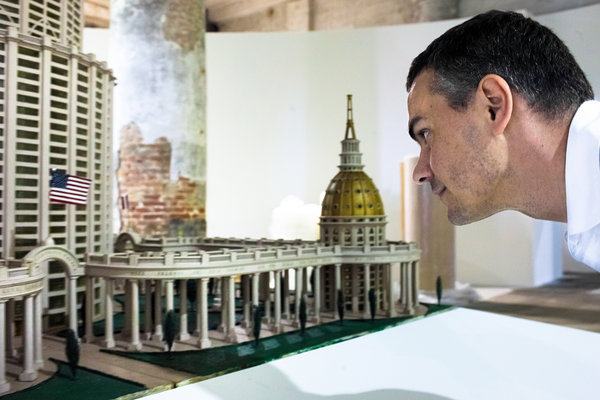 Massimiliano Gioni inspects one of the thousands of objects in his palace. (Photo: Samuele Pellecchia/NYT)