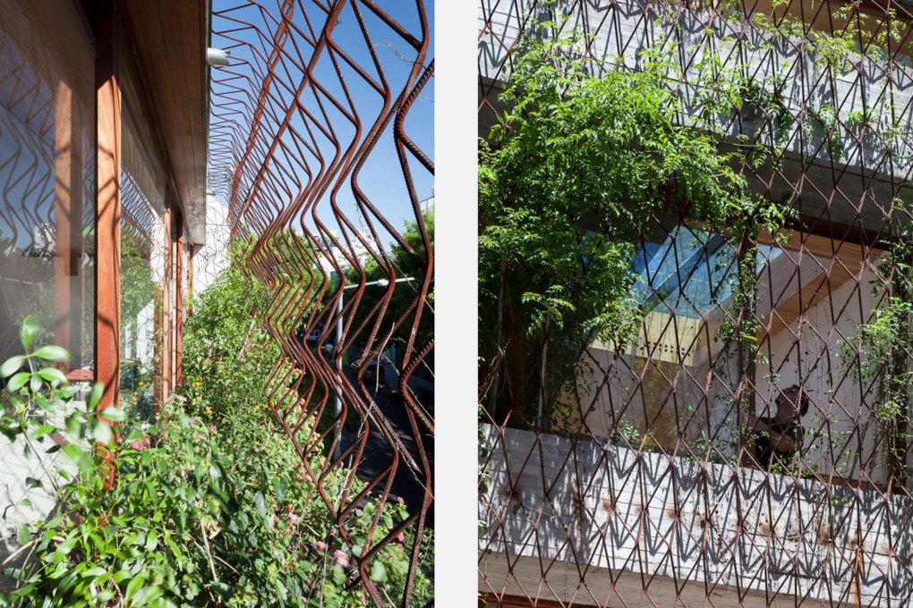 ...while the whole building is enveloped in a grill of iron bars, of the type usually used for reinforcing concrete. These act as both security grills to open windows and a trellis for plants.