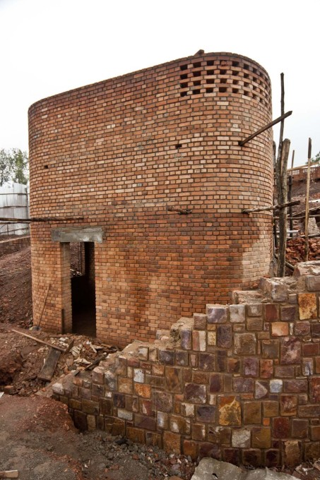 A brick core under construction of one of the 17 pavilions that make up the Center. (Photo courtesy Sharon Davis Design)