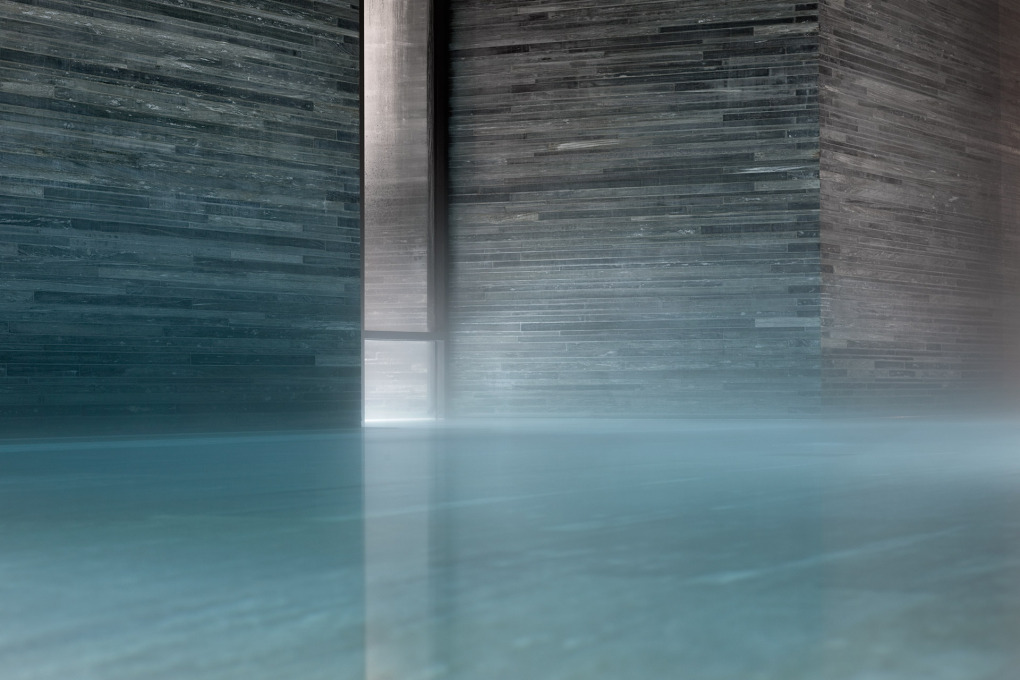 The whole structure is faced in the textured blue-grey stone of Valser Quartzite. (Courtesy Hotel Therme Vals)