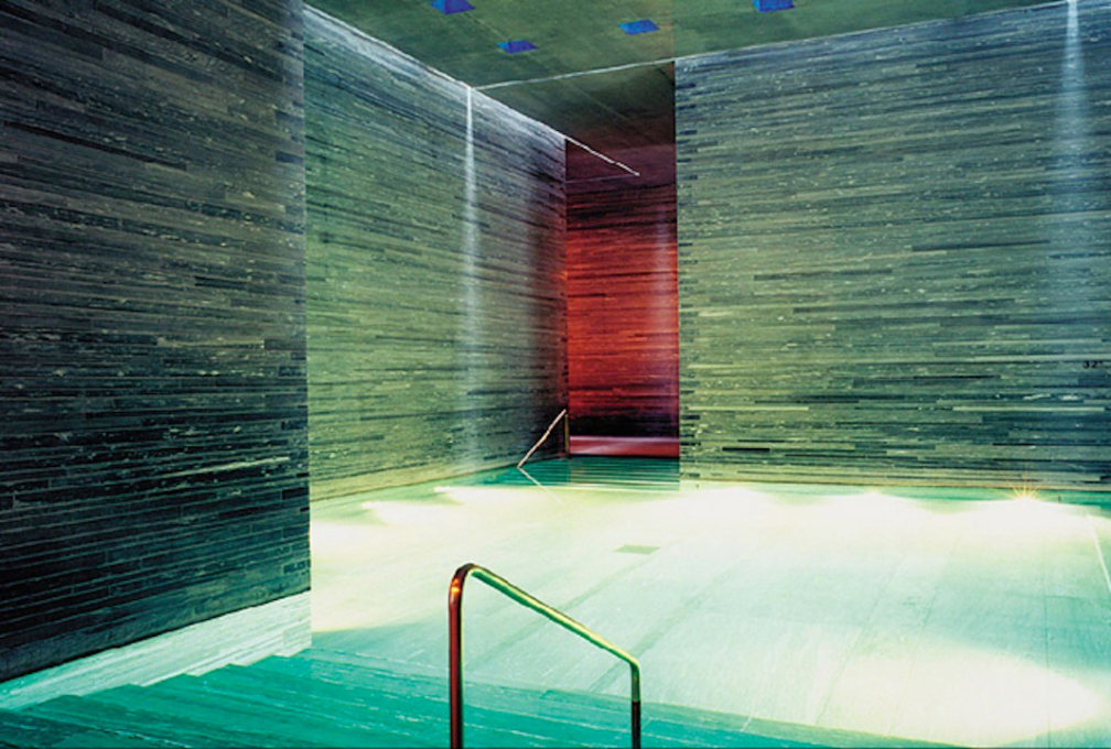 Looking through to the red glow of the fire pool. (Photo courtesy www.archdaily.com)