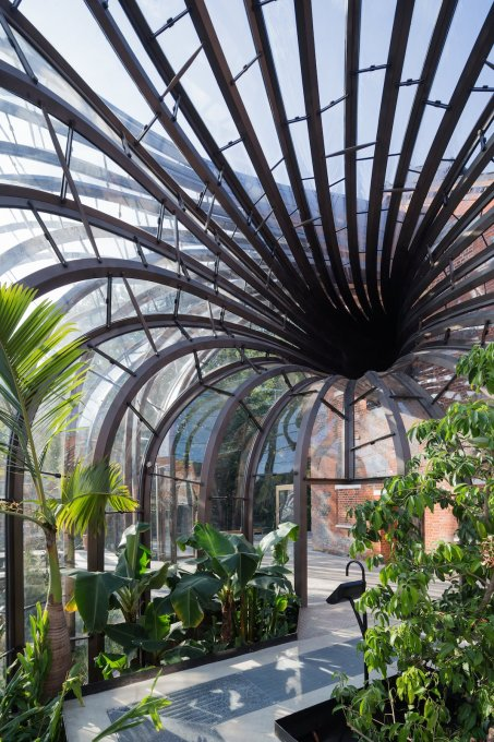 Central to the design was the creation of two new glasshouses' which sit on the waters of the now widened river. (Photo: Iwan Baan)