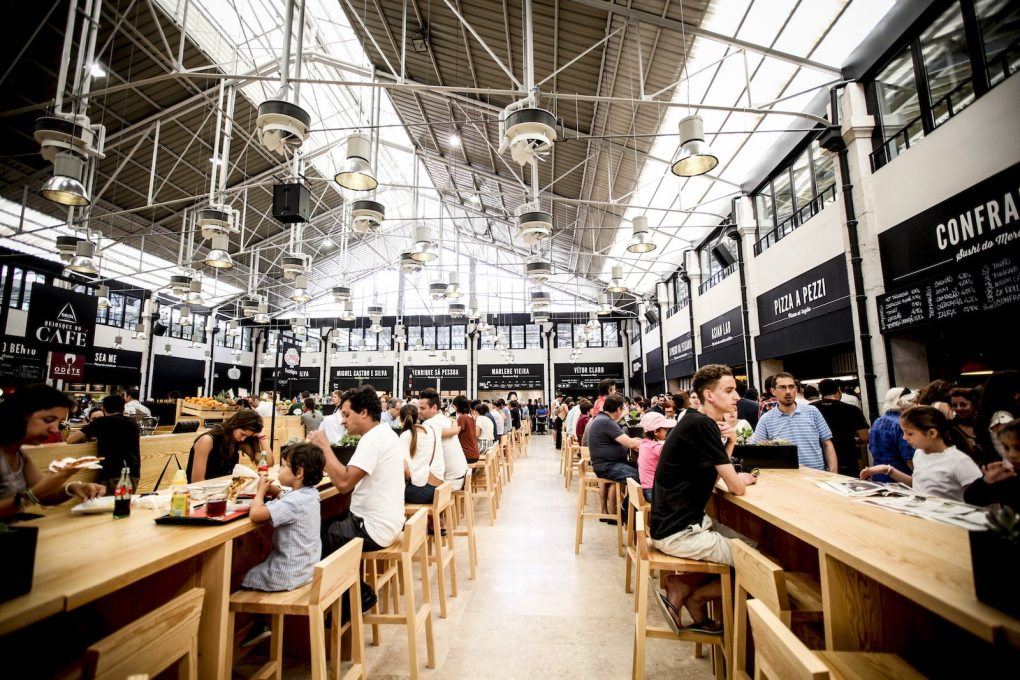 The communal eating and seating area at the newly renovated Mercado da Ribeira in Lisbon is surrounded by food outlets and shops units, above which a floor of office space is due to open. (Photo courtesy Time Out Group)