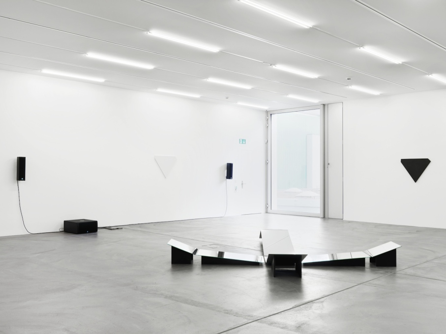 "Upstairs Trix and Robert Haussmann's ""Liegende Figur, homage à Bracelli"", (2014), an installation of flat and tilted mirrors in the centre of the space."