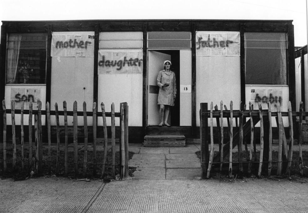 Bobby Baker with her work 'Edible Family in a Mobile Home' at her prefab Acme house in Conder Street, E1. (Photo: Andrew Whittuck, 1976, courtesy Whitechapel Gallery)