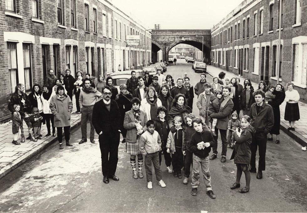Artists and their families living on Beck Road, E8 in 1988, a street previously slated for demolition. Gallerist Maureen Paley (in dark coat in front of child at rear) opened her first gallery here in 1984. (Photo: Edward Woodman)