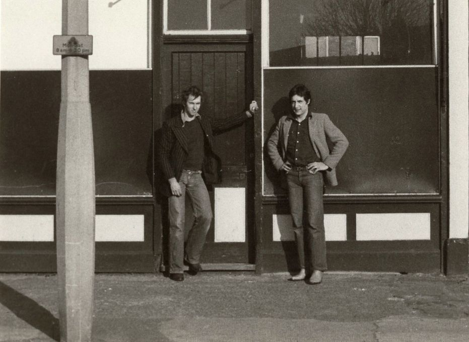 Jonathan Harvey and David Panton outside 117 Devons Road, E3 in 1974, one of the first two Acme houses to be renovated and the organisation's first office. (Photo: Claire Smith, courtesy Whitechapel Gallery)
