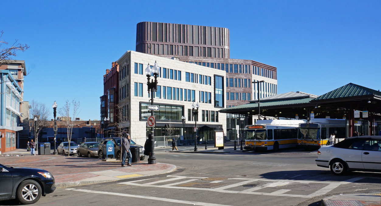 The Bolling Municipal Center opens up, with ground floor retail spaces, to the Dudley Square bus terminal, pictured here.