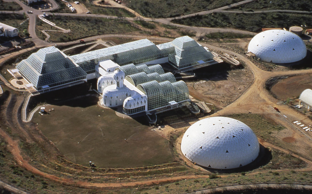 Biosphere 2 (1991), Arizona. The Wilderness Biome is shown on the upper left side, Habitat and the Agricultural Biome are in the centre and the lung domes on the right. (Courtesy Peter Jon Pearce)