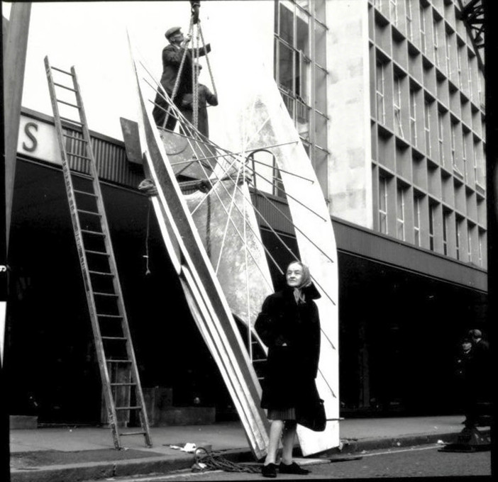 "Installation of Barbara Hepworth's ""Winged Figure"", 1961-2, Holles Street, London, with the artist looking on. (© John Lewis Partnership Archives)"