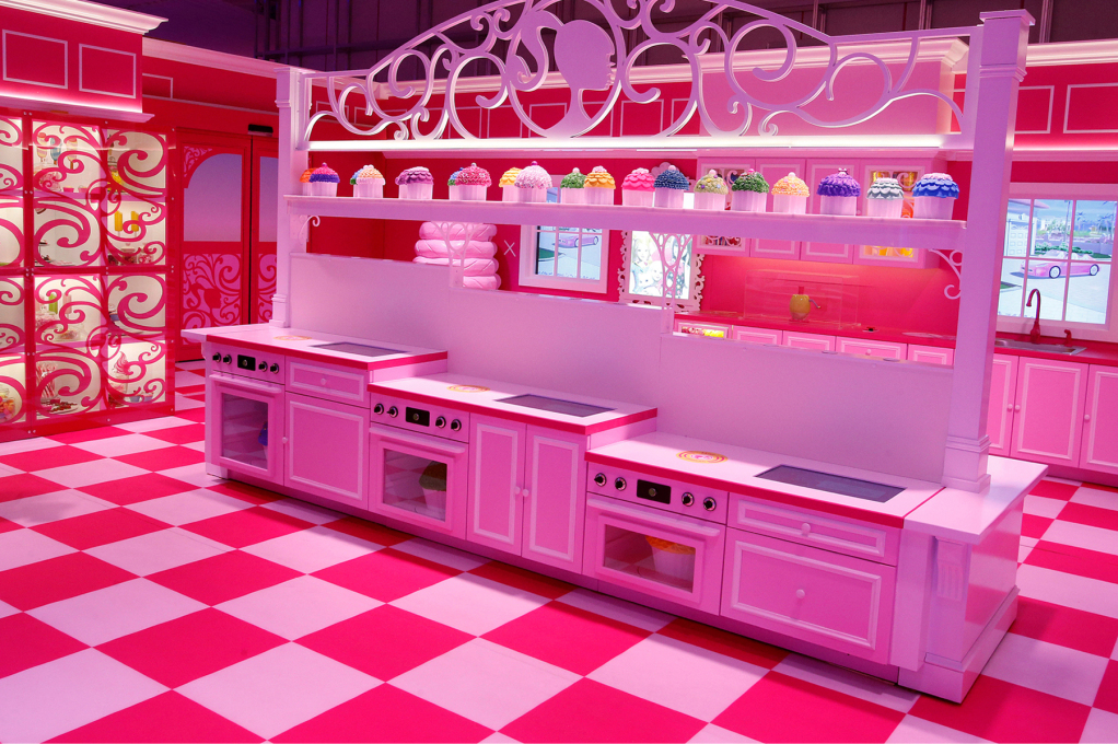 The Dreamhouse kitchen welcomes all heights to partake in the baking of a cupcake. (Photo: Mattel)