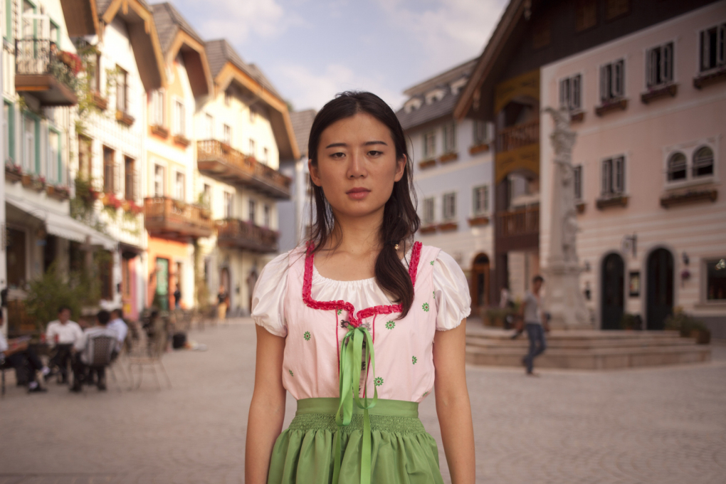 "In ""Double Happiness"", directed by Ella Raidel, Austria, 2014, the marketplace of an Austrian village is copied and implanted into a Chinese town in a fascinating exploration of cultural identity and collective histories."
