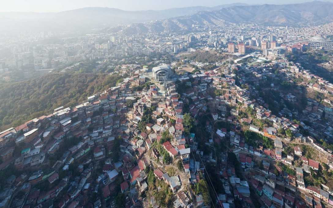 """Looking down on Hornos de Cal Metrocable station in the barrio of San Augustín"", Caracas. (Image: Iwaan Baan, courtesy Verso)"