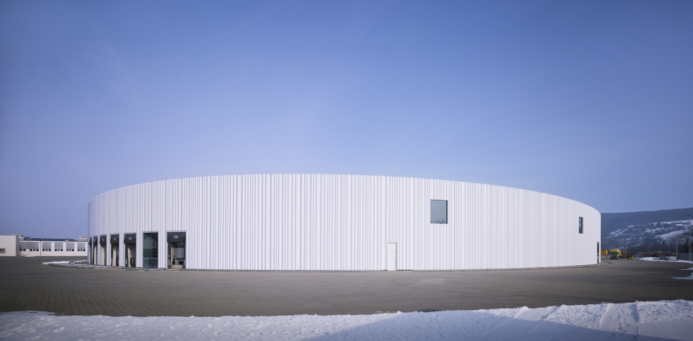 The building façade clad in 11-meter white acrylic glass panels... (Photo: Julien Lanoo © Vitra)