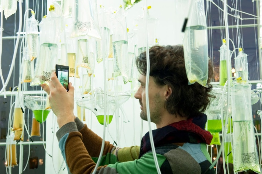 Cyber-Gardening the City by ecoLogicStudio, an algae cultivation experiment in Österlen, Sweden, invited the public to supply CO2 to a hanging garden of algae by breathing into a tube. (Photo: Sue Barr)