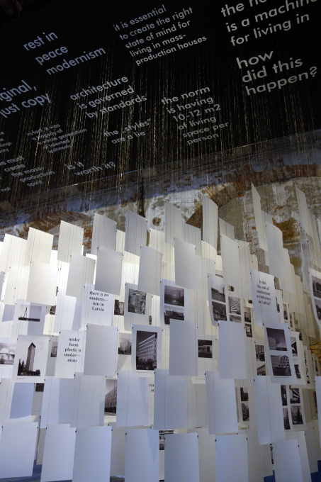 The installation is basically made from the 489 pages of the catalogue, mixing images of post-war modernist buildings in Latvia with slogans and quotes from the essays in the book. (Photo: NRJA)