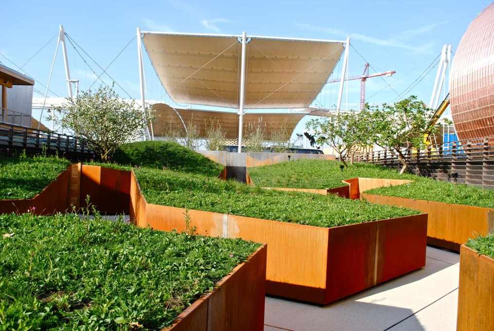 "The raised ""apple orchard and meadow"" within the UK Pavilion. Luckily the Expo theme is ""food"", you could fry eggs on the heat of the steel cladding panels. (Photo: Orlando Lovell)"