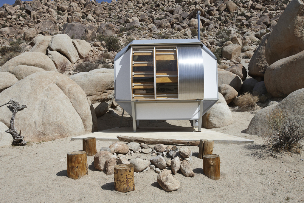 ...It includes individual bedroom pods called 'Wagon Stations', communal kitchen, open-air showers composting toilets