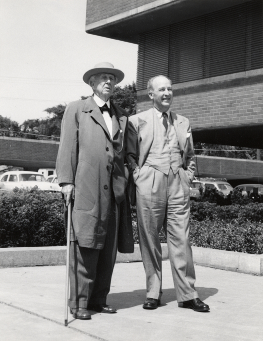 Frank Lloyd Wright and H.F. Johnson, Jr. admiring the Research Tower, 1953.