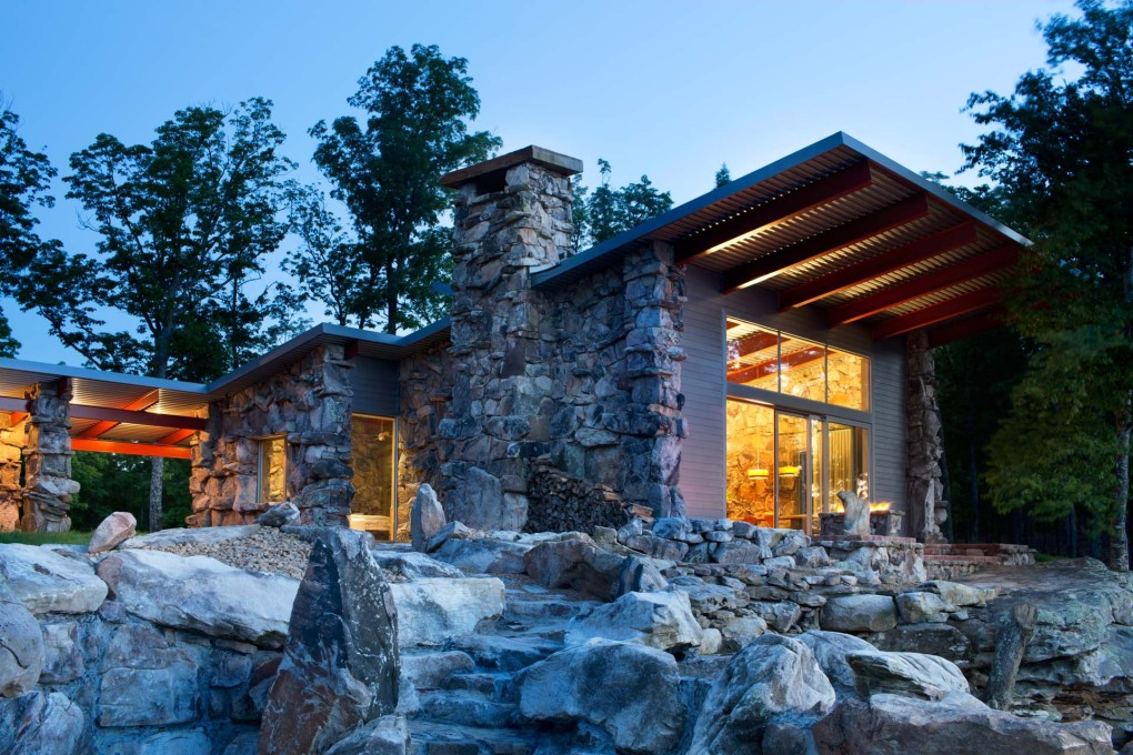The design intent was to ground the house in the place, making it part of the bluff.